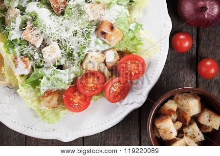 Caesar salad with roman lettuce, parmesan cheese, croutons and dressing