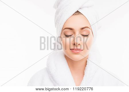 Young Pretty Cute Girl With Towel On Her Head And Closed Eyes