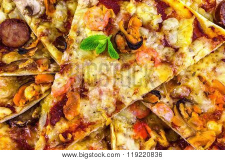 Freshly Baked Pizza With Salami, Mussels And Shrimp, Fried Pieces Of Close-up