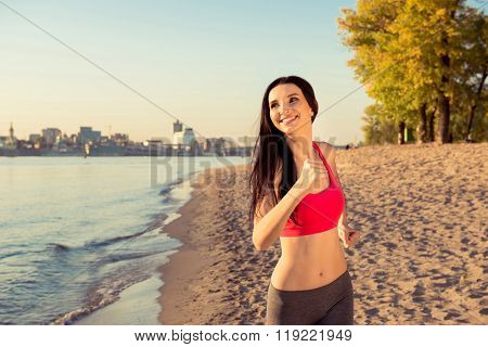 Cute Happy Young Girl Running On The Beach To Keep Fit