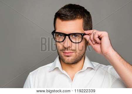 Smart Man  Touching His Glasses