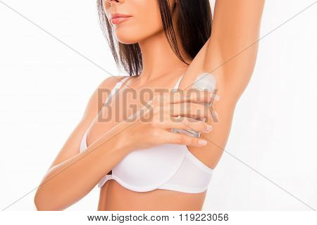Close Up Photo Of Healthy Young Woman  Using Deodorant.