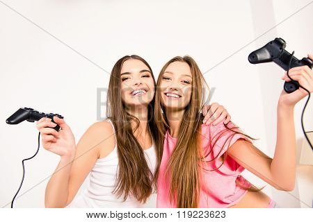 Cheerful Happy Attractive Girls Playing Video Games At Home