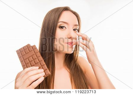 Sexy Cute Girl Licking Her Finger With Milk Chocolate