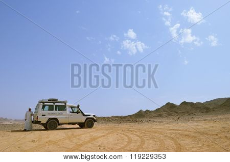 A Bedouin And A Tourist Car