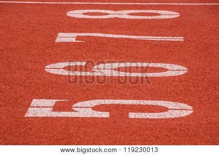 Start and Finish point of race track Close up running track number six.