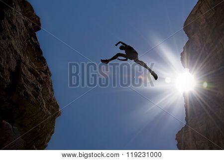 Man Jump Through The Gap In The Mountain