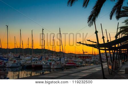 Magenta sunset harbour.  Warm sunny day in tourist hot spot - Ibiza's off-season,