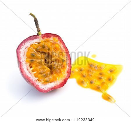Passion Fruit Cut Out With Some Juice On A White Background