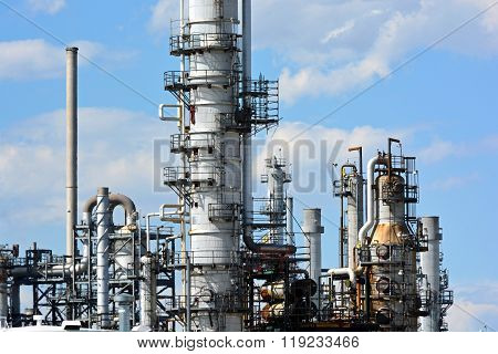 Oil Refinery Distillation Towers On A Sunny Day