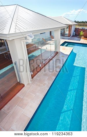 Top View Of The Modern And Luxury Swimming Pool Of A Hotel Or House With Blue Sky