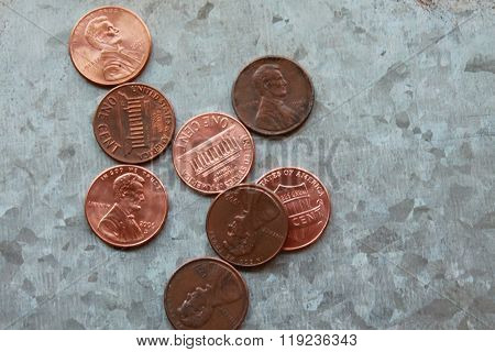 Pennies on a silver metal background