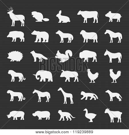 Vector set of domestic and wild animals. White silhouettes of animals on a black background. Deer beaver sheep horse fox bison lion buffalo panther giraffe monkey and other animals.