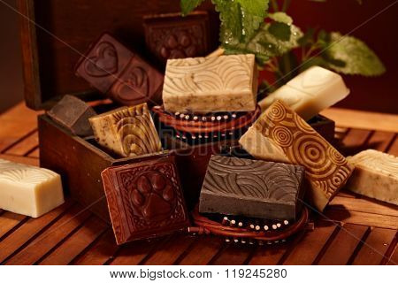 Still-life with natural soap bars arranged in a wooden box.