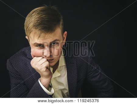 Sad young man in a business suit