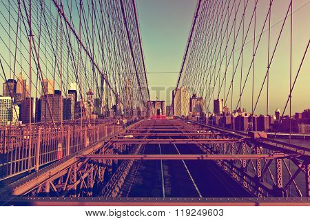 Retro Color View of Deserted Brooklyn Bridge with Detail of Girders and Support Cables Looking Toward Manhattan City Skyline at Sunset, New York City, New York, USA