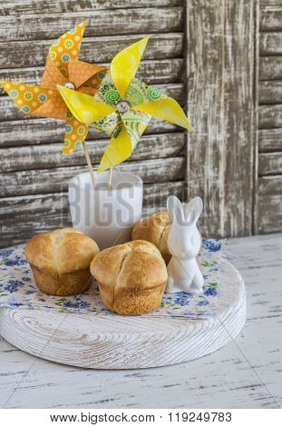 Sweet Brioche, Easter Ceramic Rabbit And Homemade Paper Pinwheel. Easter Home Baking And Easter Deco