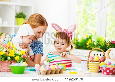 Happy Family Mother And Children Preparing For Easter, Paint Eggs