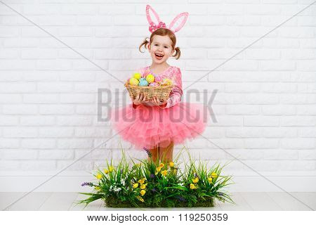 Happy Chil In Costume Easter Bunny With Eggs And Green Grass With Flowers