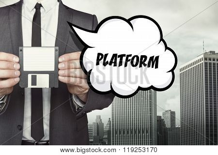 Platform text on speech bubble with businessman holding diskette