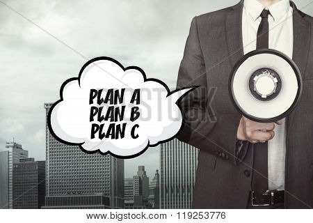 Plan concept text on speech bubble with businessman and megaphone
