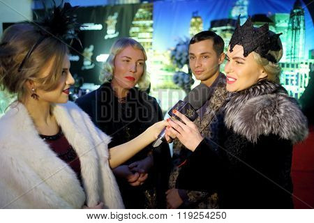 MOSCOW - APR 26, 2015: Guests give interviews at a party in honor of the birthday the glossy magazine LF city in karaoke club Chicago