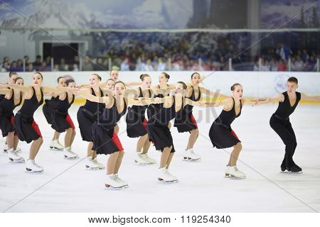 MOSCOW - APR 26, 2015: The group of girls in black costumes with a boy performs on the skate at the Cup in synchronized figure skating in the sports complex Olympiysky