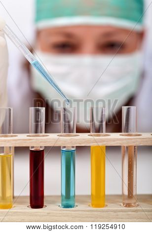 Chemical Experiment - Woman With Pipette And Test-tubes