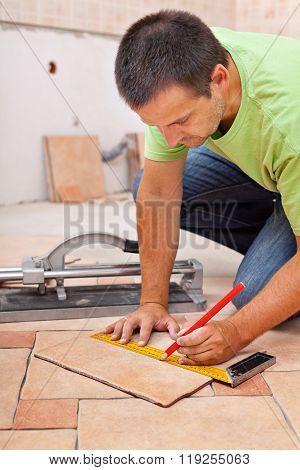 Worker Installs Ceramic Tiles
