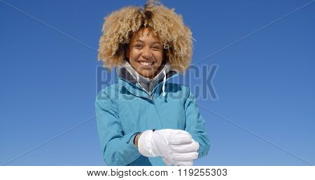 Cute woman in frizzy hair and winter coat