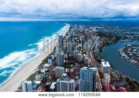 City by the beach at dusk aerial view from above. Surfers Paradise district Gold Coast Queensland Australia at dusk aerial view