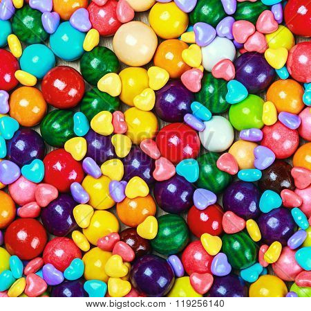 multicolored candy and chewing gum background rainbow