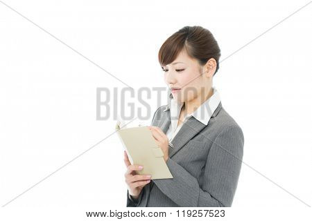 Beautiful asian business woman isolated on white background