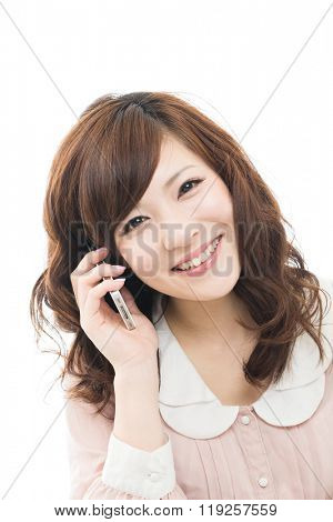 Beautiful asian woman with the cell phone