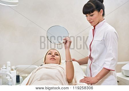 woman in spa salon with mirror