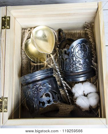 nickel silver dishes in a wooden box
