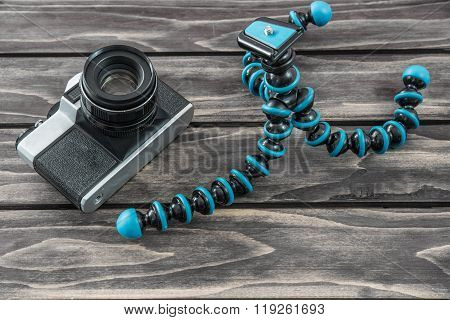 Close Up View Of A Flexible Type Tripod And Vintage Camera