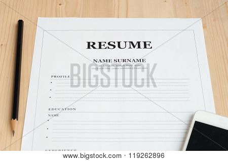 Office Desk With Resume Information .