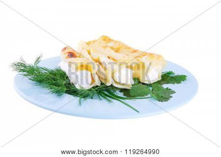 cheese cannelloni served with vegetables on blue plate