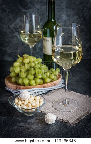 Bottle Of White Wine, Two Glasses And Bunch Of Grapes