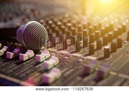 Microphone Resting On A Sound Console