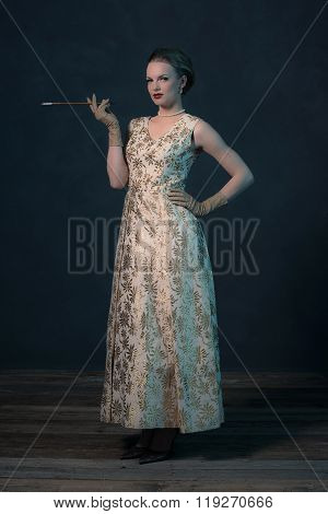 Sensual Retro 1950S Posh Fashion Woman In Gold Dress Holding Cigarette Pipe.