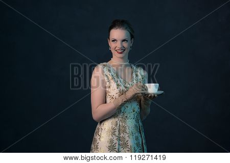 Smiling Chic Vintage 1950S Fashion Woman Holding White Tea Cup.