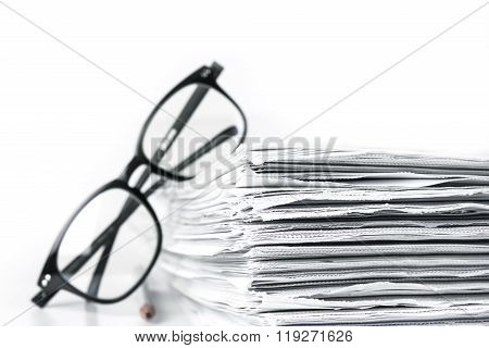 Reading Eyeglasses With Stacking Of Newspaper Background , Business Information Concept