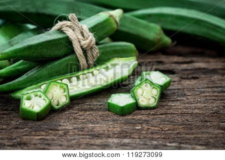 Close Up Fresh Okra On Wooden Plate