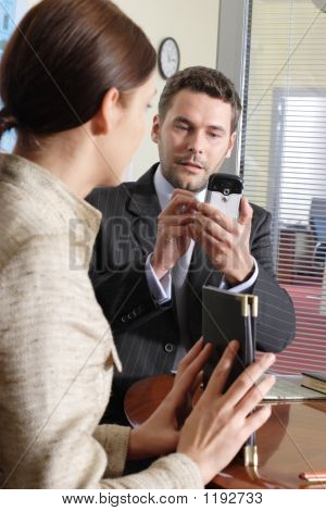 Business Man And Woman Working In The Office