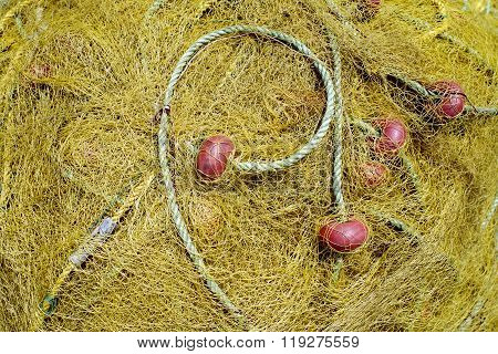 Yellow Net For Fishing With Rope And Red Benefits