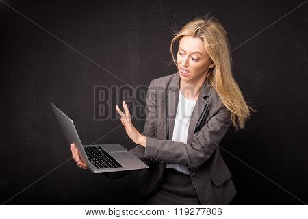 Woman being disgusted over something she saw on computer
