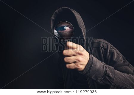 Bizarre Hooded Spooky Person With Magnifying Glass
