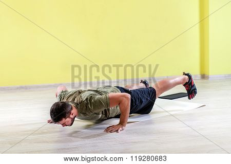 Man at gym, exercising with friction pads